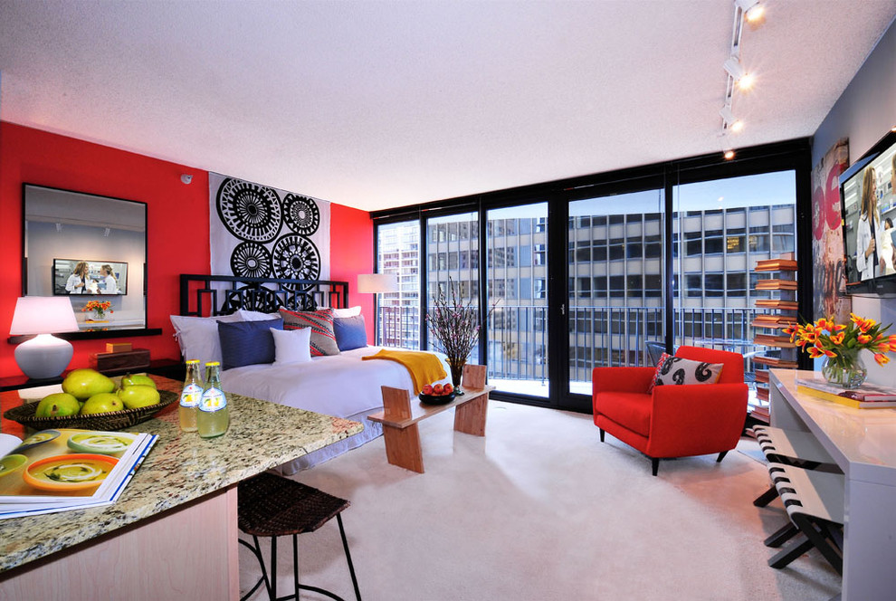 Example of a trendy bedroom design in Chicago with red walls