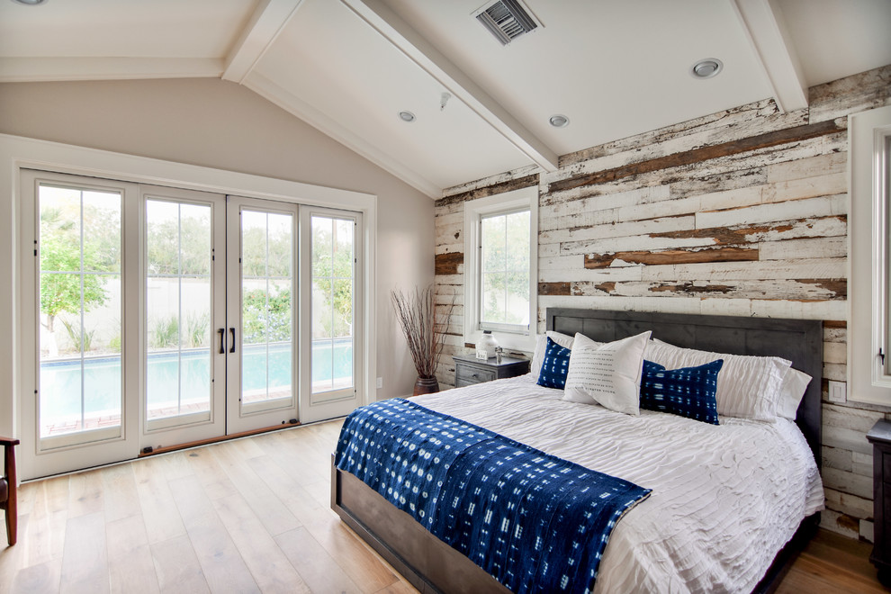 Example of a large mountain style master medium tone wood floor and brown floor bedroom design in Phoenix with beige walls and no fireplace