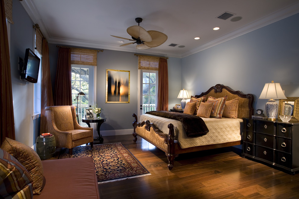 Example of a classic dark wood floor bedroom design in Miami with blue walls