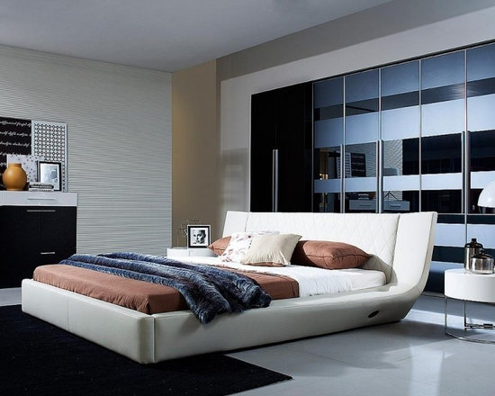 Arctic - Modern White Leather Bed With Speakers and Iphone Audio Dock - This is a beautiful modern bed, it has a USB Bluetooth built in, SD card slot, cell phone plug, iPhone solutions, and 2 speakers embedded in the corner of lounge part. With its very comfy plush back board to rest it's sure to be one of your favorite spots in your living space.