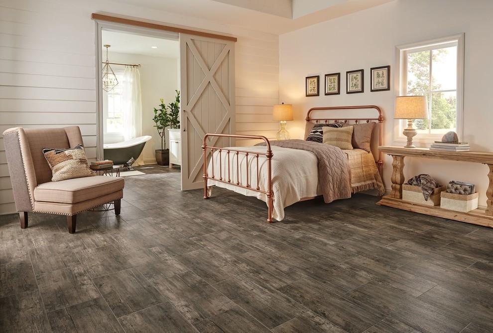 Inspiration for a large cottage master porcelain tile bedroom remodel in Newark with white walls