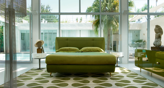 Inspiration for a modern green floor bedroom remodel in Miami with no fireplace