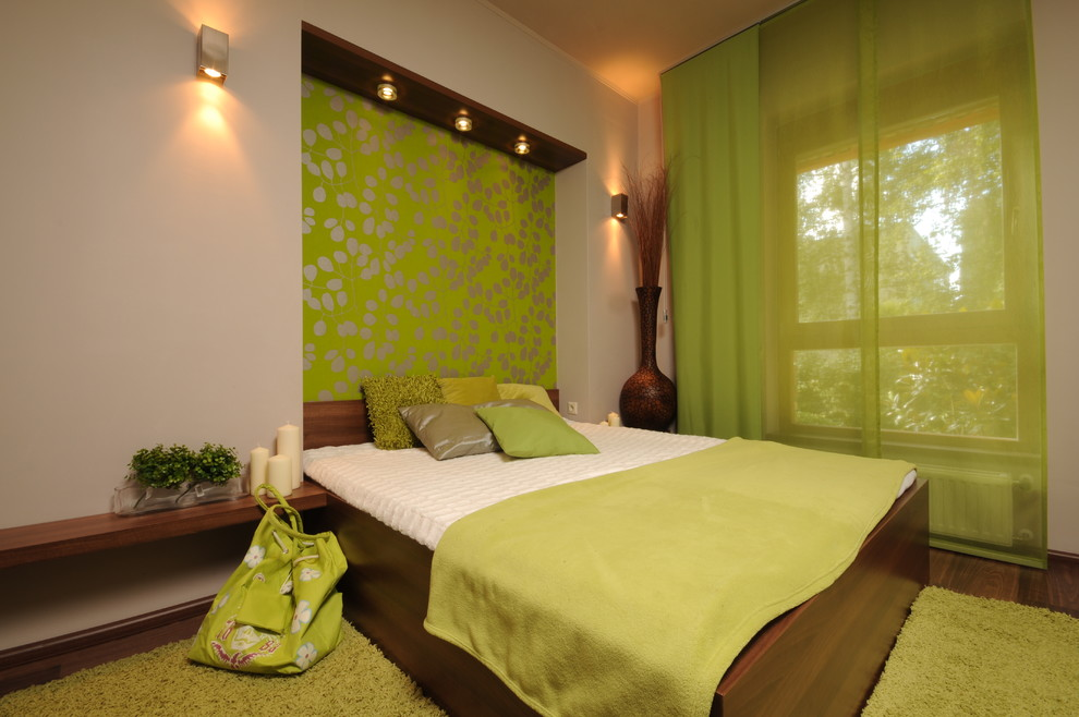 Inspiration for a contemporary green floor bedroom remodel with green walls