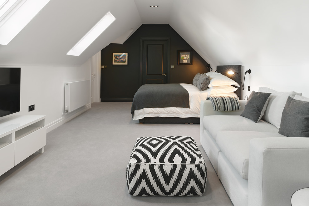 Photo of a contemporary bedroom in Kent with white walls, carpet and no fireplace.