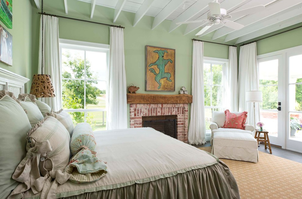 Country bedroom photo in Dallas with green walls, a standard fireplace and a brick fireplace