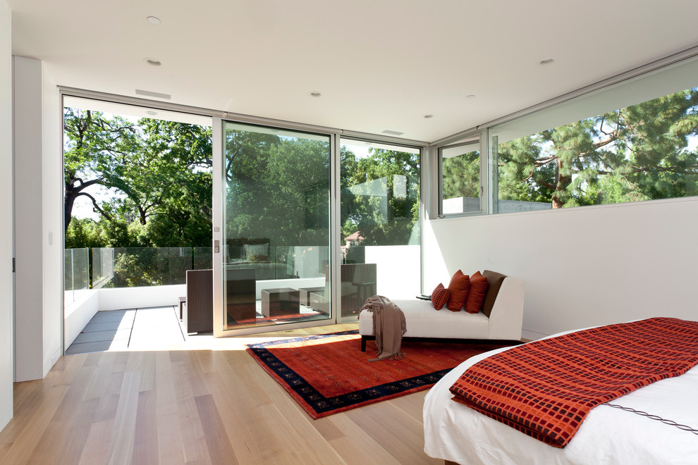 Inspiration for a large modern master light wood floor bedroom remodel in San Francisco with white walls and no fireplace