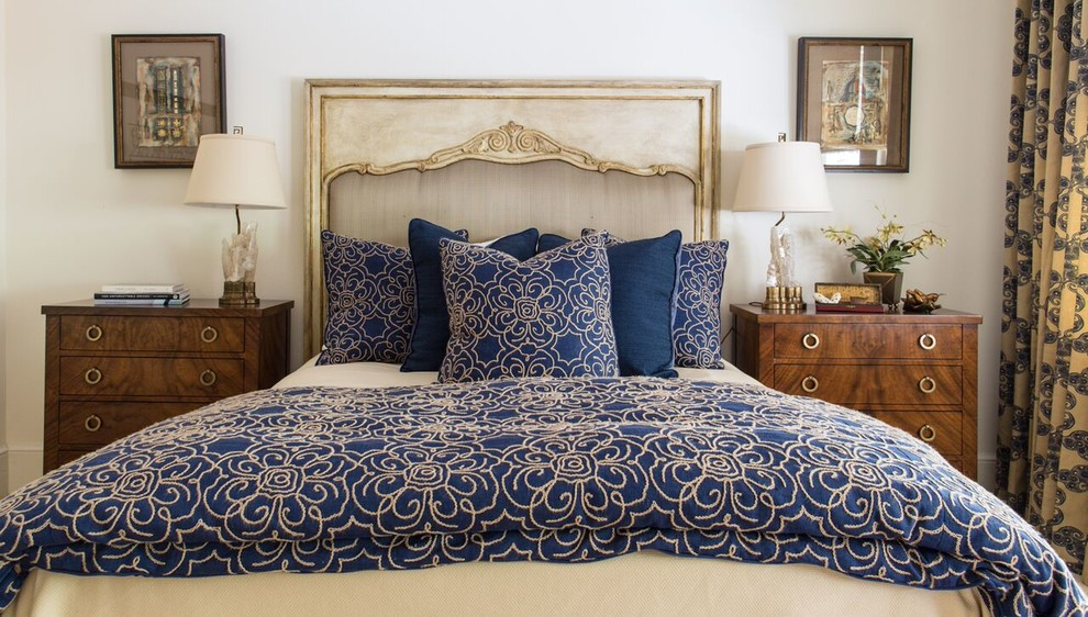 Inspiration for a large transitional master bedroom remodel in New Orleans with beige walls and no fireplace
