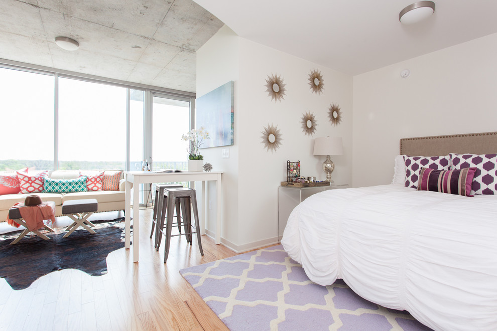 Small danish light wood floor bedroom photo in Austin with white walls