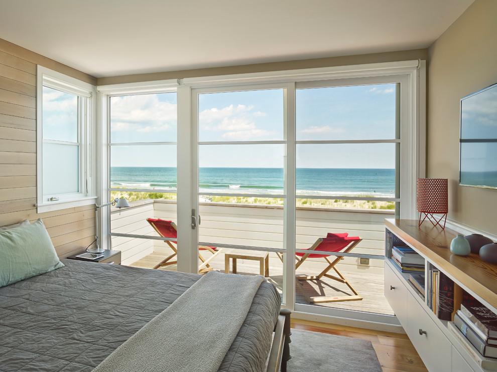Example of a beach style medium tone wood floor bedroom design in Philadelphia with beige walls