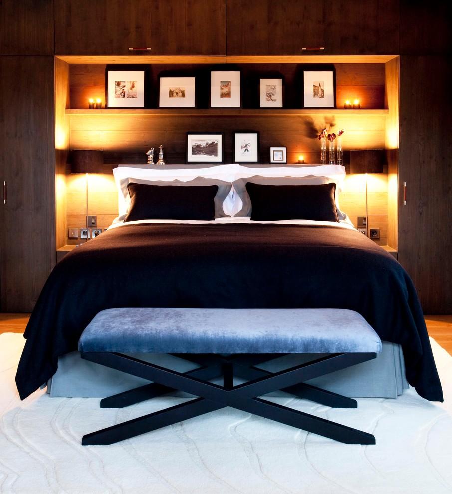 Trendy medium tone wood floor bedroom photo in Cornwall