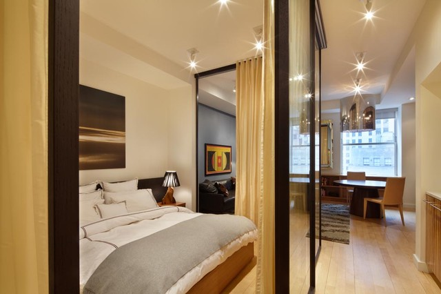 small apartment living room. Contemporary light wood floor bedroom idea in New York with white walls Small Apartment Living Room Design  Houzz