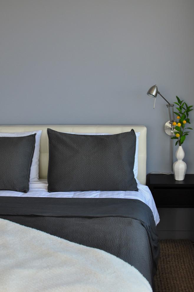 Bedroom - contemporary bedroom idea in Austin with gray walls
