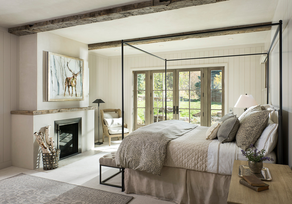 Mountain style bedroom photo in Other with white walls and a standard fireplace
