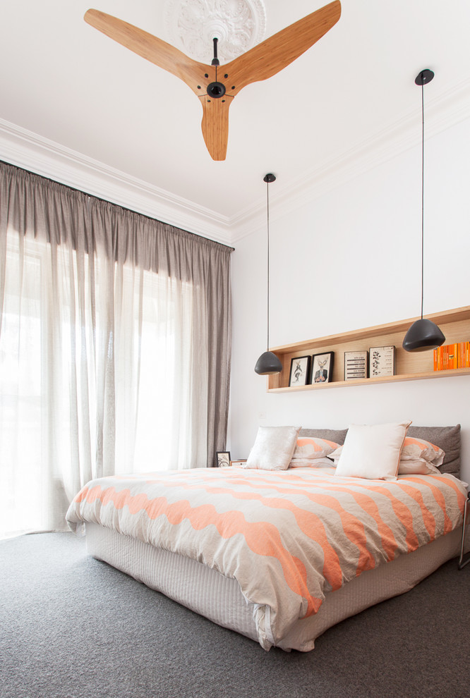 Inspiration for a mid-sized contemporary carpeted bedroom remodel in Melbourne with white walls and no fireplace