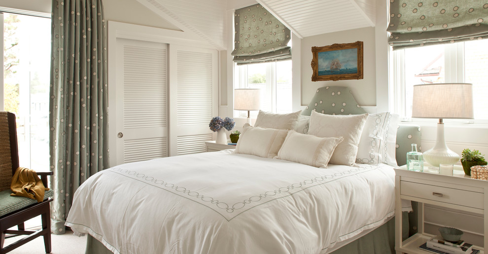 Beach style bedroom photo in Orange County with gray walls and no fireplace