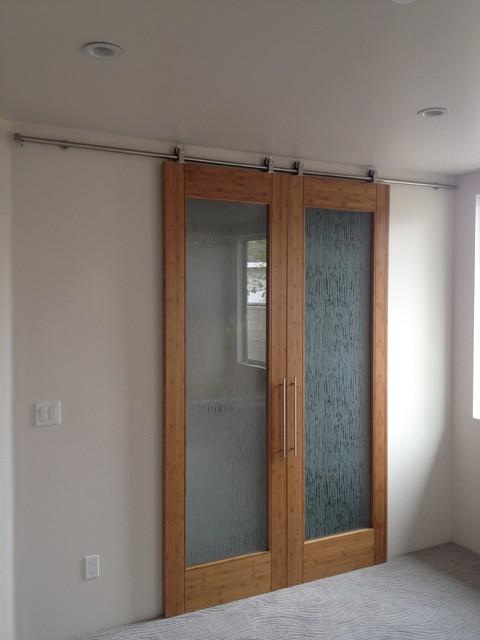 Bamboo door on barn door style hardware contemporary for Bedroom barn door hardware