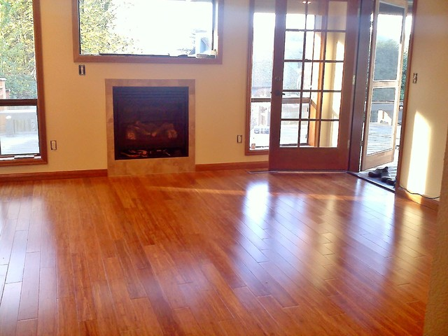 Bamboo Flooring Added Picture Window And Gas Fireplace