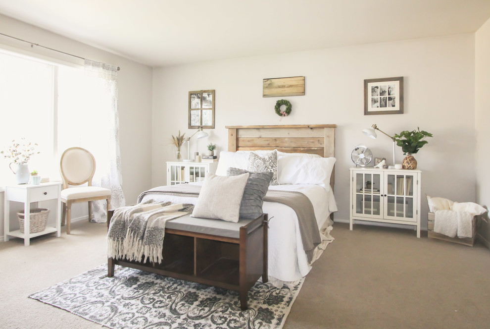 Inspiration for a country carpeted bedroom remodel in Seattle with beige walls
