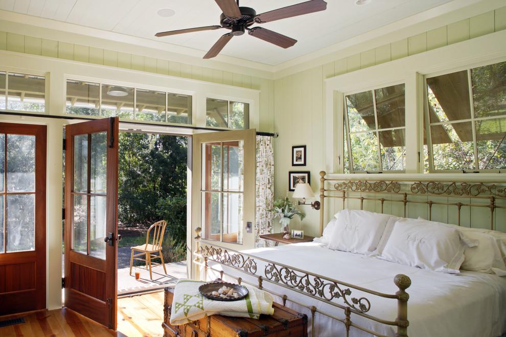 Bedroom - rustic medium tone wood floor bedroom idea in Atlanta with green walls