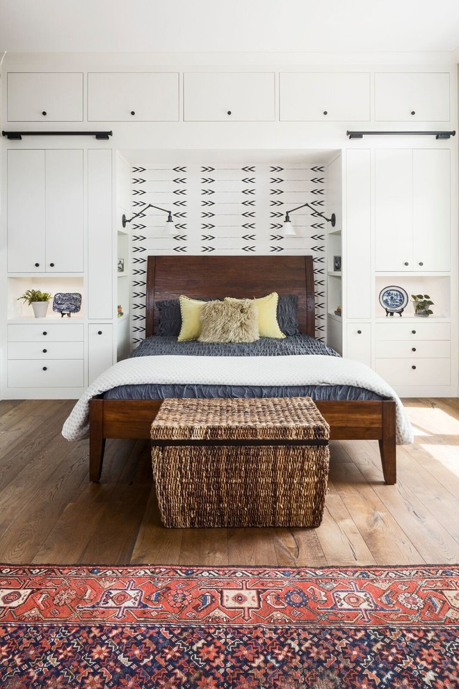 Bedroom - huge country master medium tone wood floor and brown floor bedroom idea in Austin with beige walls, no fireplace and a brick fireplace