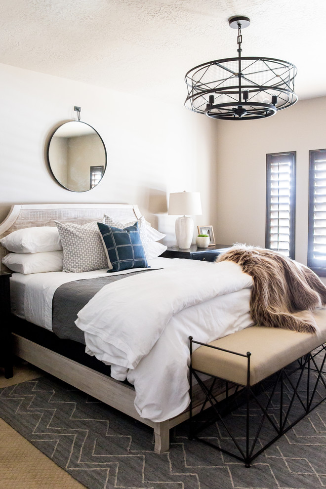 Example of a transitional master carpeted and beige floor bedroom design in Salt Lake City with beige walls
