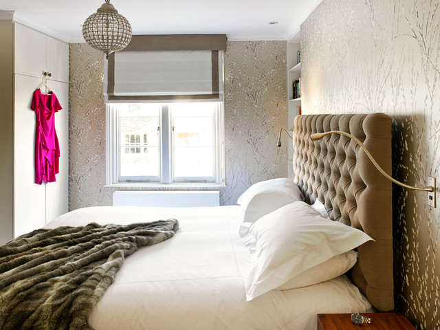 Photo of a contemporary master bedroom in London.