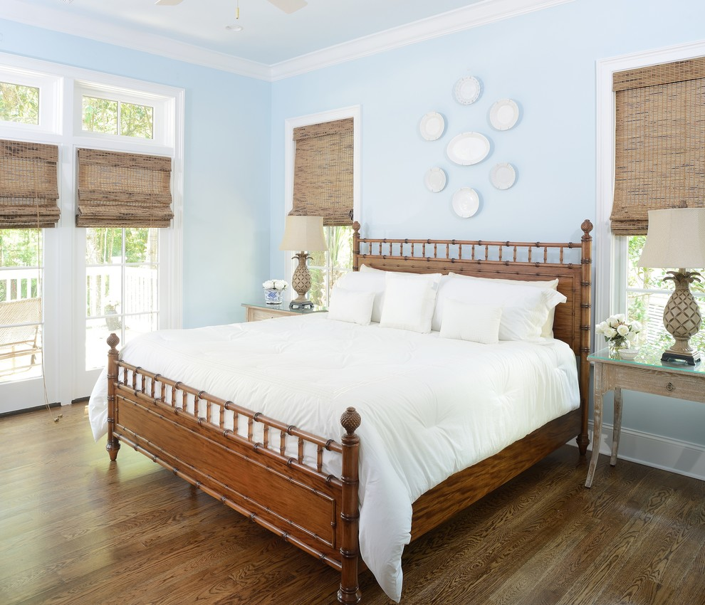 Example of a beach style dark wood floor bedroom design in Charleston with blue walls