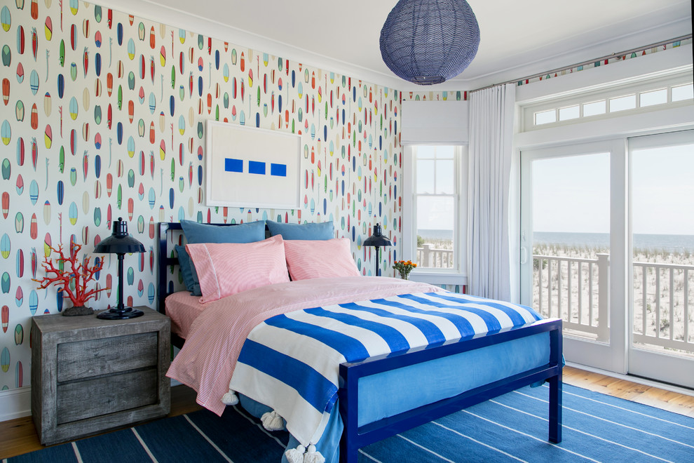Inspiration for a mid-sized coastal medium tone wood floor and brown floor bedroom remodel in New York with multicolored walls