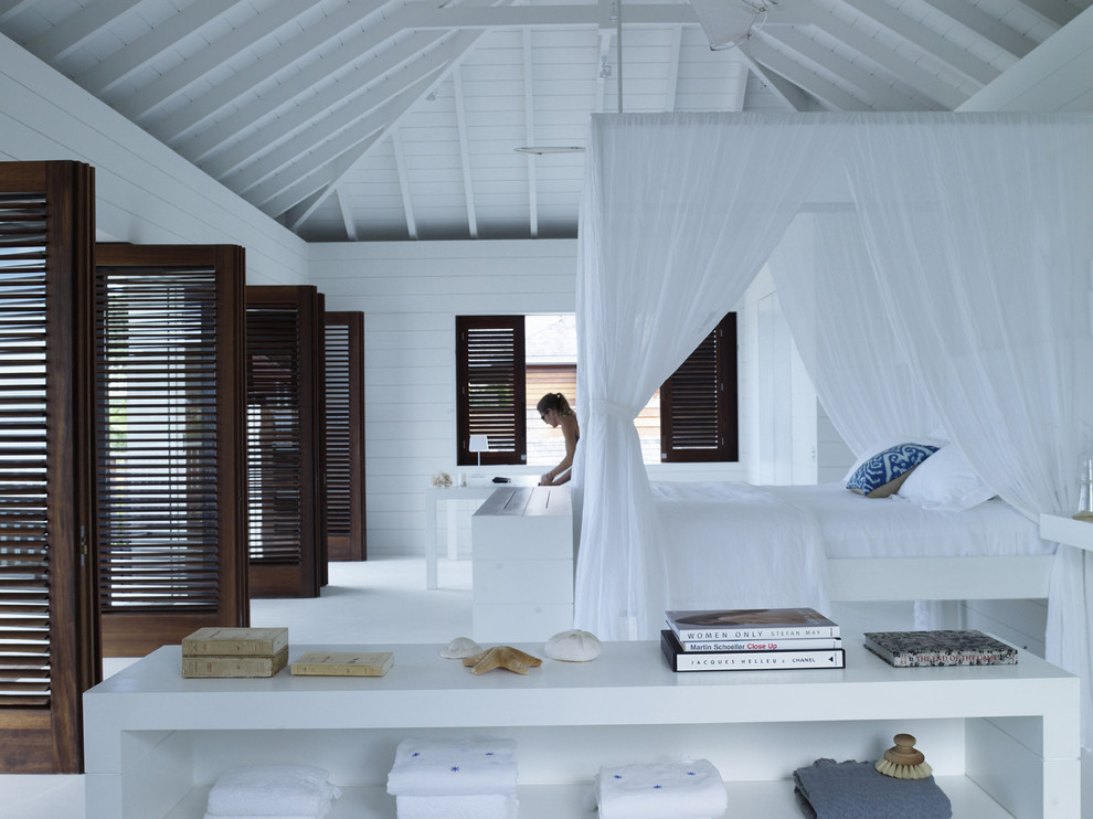 Example of a huge island style bedroom design in Other
