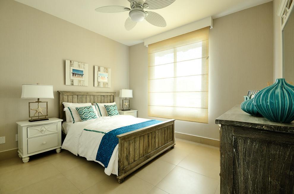 Bedroom - beach style ceramic floor bedroom idea in Other with beige walls