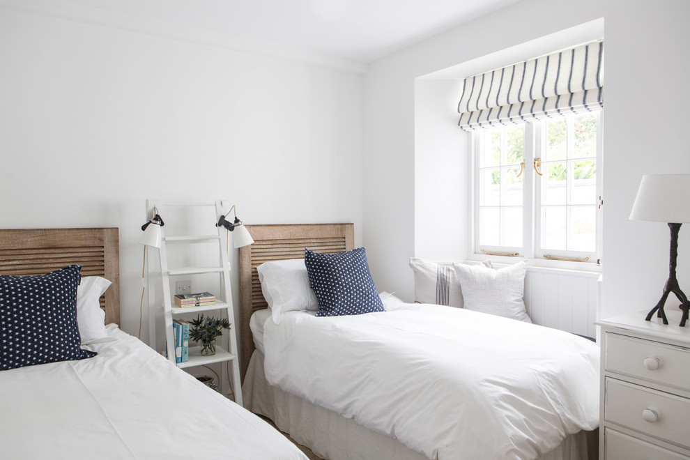 Inspiration for a coastal guest bedroom remodel in London with white walls
