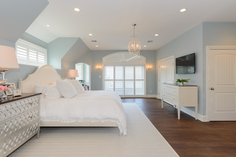 Transitional dark wood floor bedroom photo in New York with blue walls and no fireplace