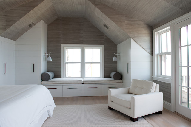 Example of a coastal light wood floor bedroom design in Boston with white walls