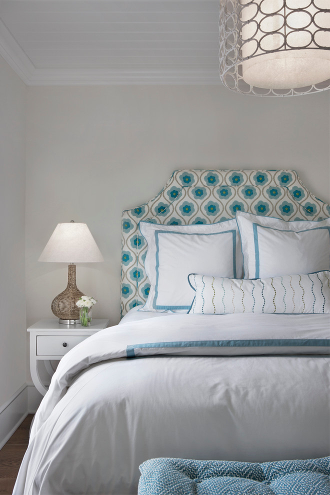 Bedroom - beach style guest bedroom idea in Other with white walls