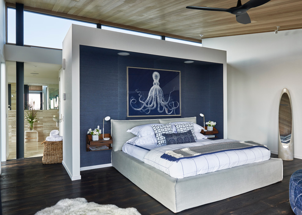 Inspiration for a beach style dark wood floor bedroom remodel in New York
