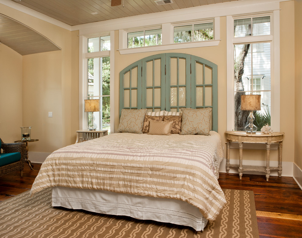 Inspiration for a coastal master dark wood floor bedroom remodel in Charleston with beige walls and no fireplace