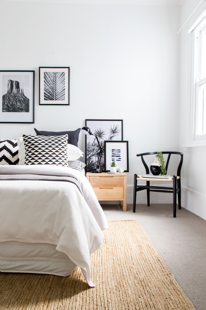 Inspiration for a mid-sized scandinavian carpeted and beige floor bedroom remodel in Sydney with white walls