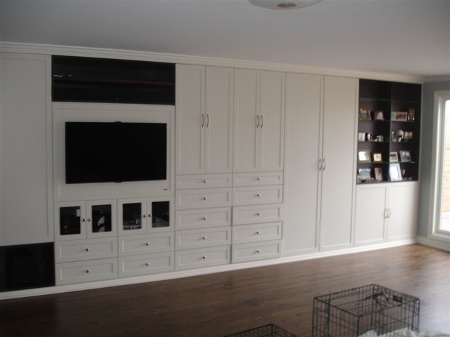 Beautiful master closet in white traditional bedroom - Beautiful bedroom built in cupboards ...