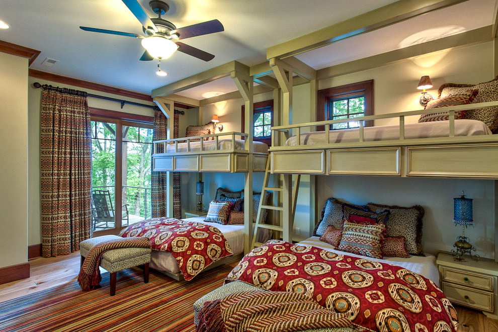 Inspiration for a timeless medium tone wood floor bedroom remodel in Other with green walls