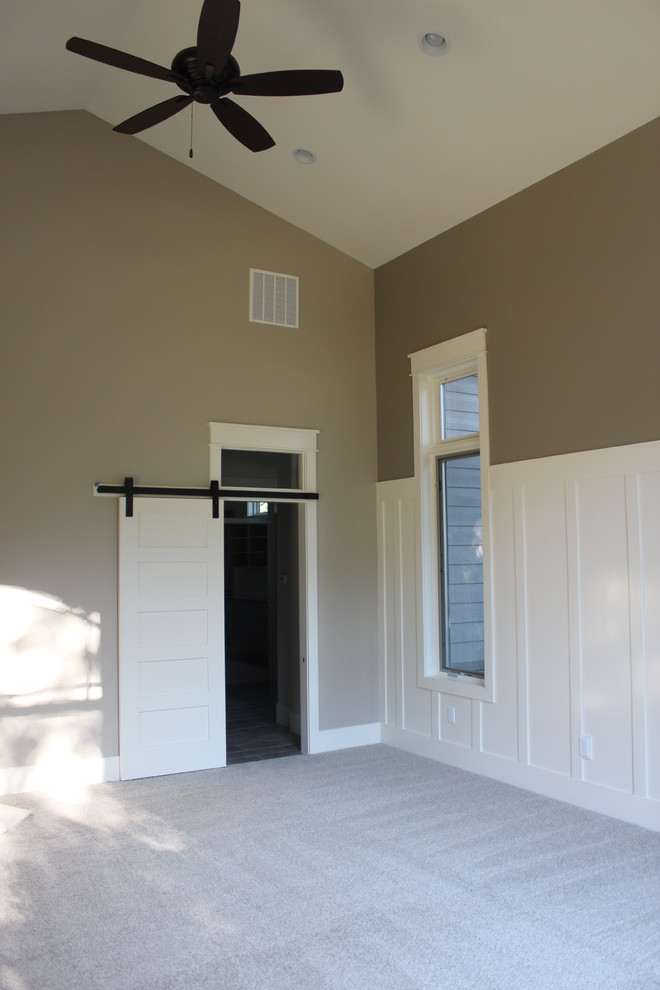 Inspiration for a large transitional master carpeted bedroom remodel in Salt Lake City with beige walls, a corner fireplace and a tile fireplace