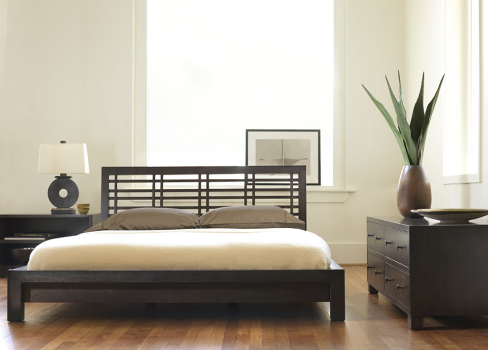 Bedroom - contemporary medium tone wood floor bedroom idea in Philadelphia with white walls and no fireplace
