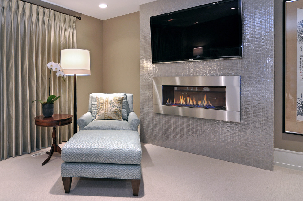 Inspiration for a transitional bedroom remodel in Calgary with a ribbon fireplace and a metal fireplace