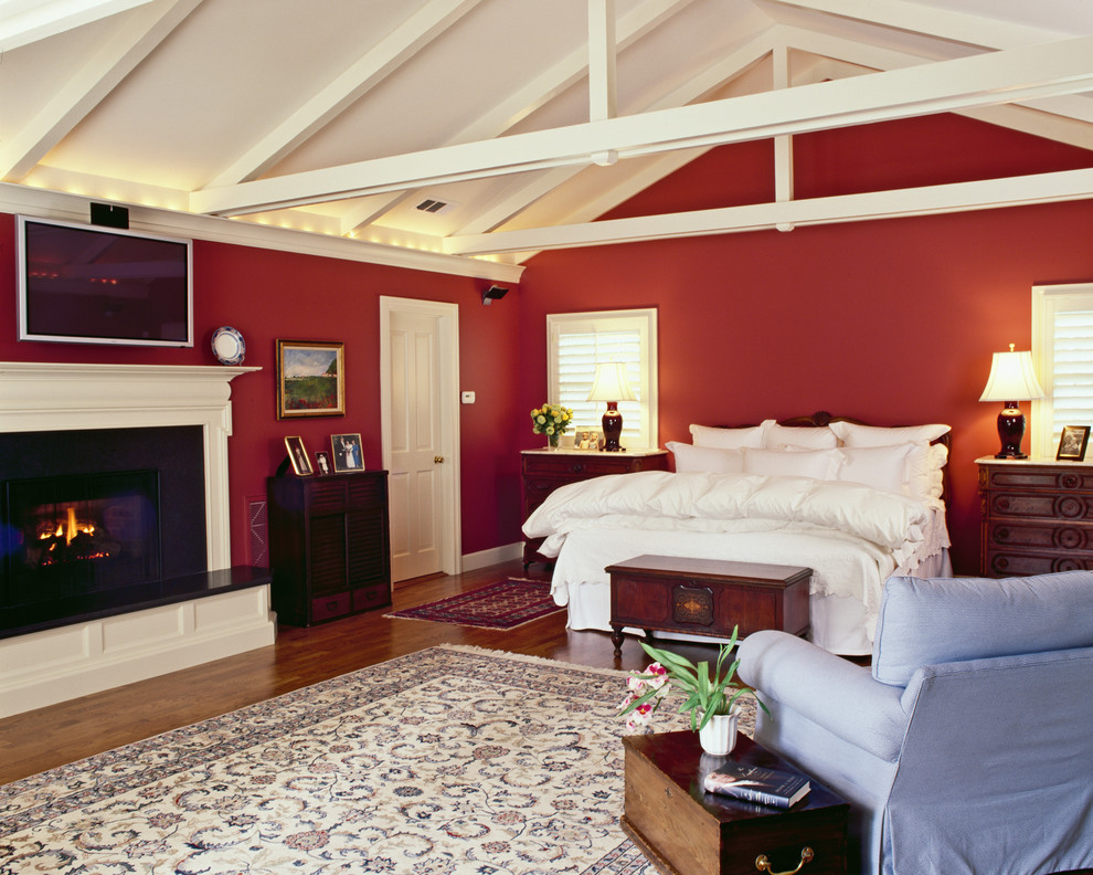 Elegant bedroom photo in San Francisco with red walls
