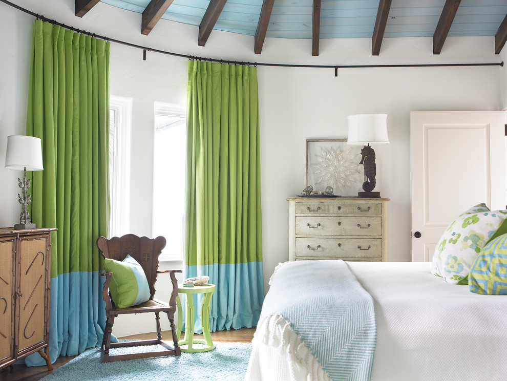 Example of a beach style bedroom design in Atlanta with white walls
