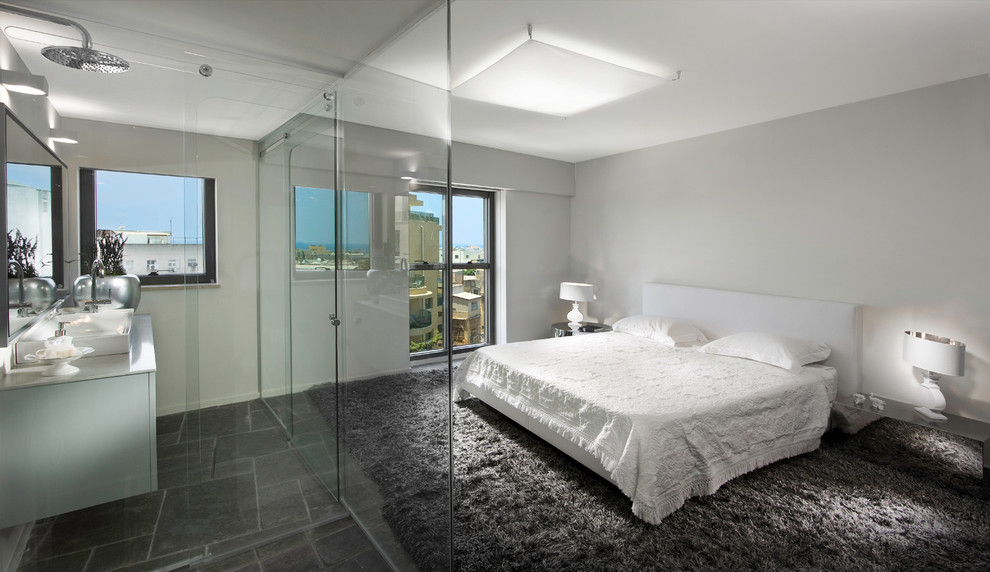 Inspiration for a contemporary master slate floor bedroom remodel in Other with white walls and no fireplace