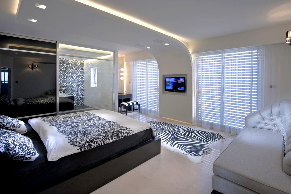 Bedroom - contemporary bedroom idea in Other with beige walls