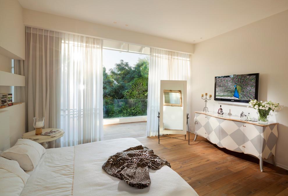 Bedroom - eclectic medium tone wood floor bedroom idea in Other with beige walls