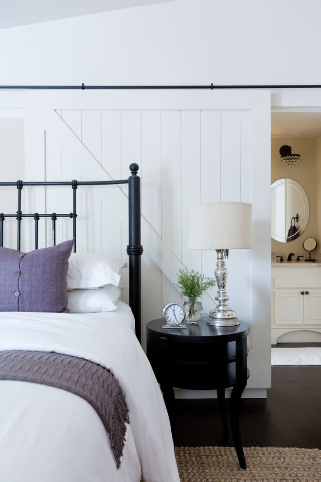 Inspiration for a mid-sized transitional master dark wood floor bedroom remodel in Los Angeles with beige walls and no fireplace