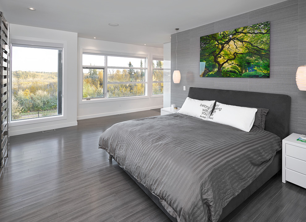Inspiration for a contemporary bedroom remodel in Edmonton with gray walls