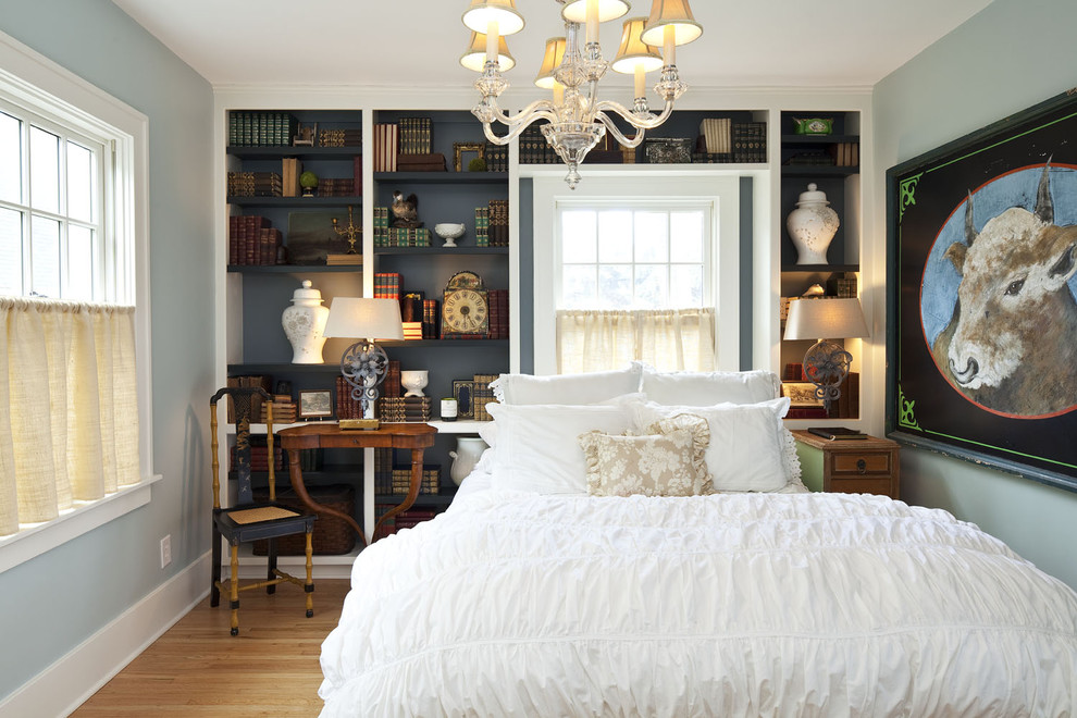 Inspiration for a timeless guest light wood floor bedroom remodel in Minneapolis with blue walls and no fireplace